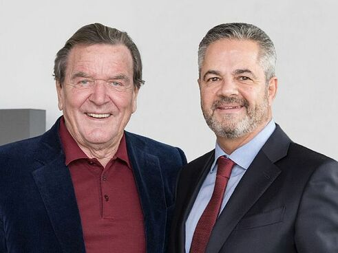 Gerhard Schröder (links), Michael Reizel (Bild: BVUK)